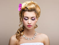 Wedding. Beautiful Thinking Bride with Diamond Necklace. Elegance & Femininity Stock Images