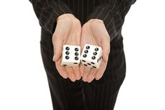 Woman with dice. A businesswoman in a pinstripe suit holds a large pair of dice Stock Photos