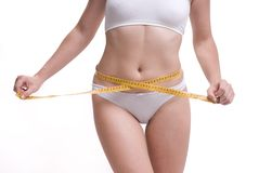 Woman diet. Woman misuring her abdomen with meter Stock Photo