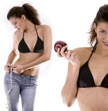 Woman on diet. Beautiful young attractive slim woman measuring her waist Royalty Free Stock Photos