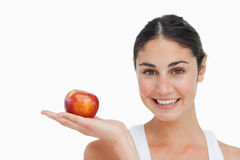 Woman on diet with an apple in the hand. Against a white background Stock Photography