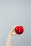 Woman on diet with an apple in the hand against gray background Stock Photo