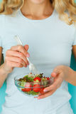 Woman diet concept portrait. Female model eating green salad Royalty Free Stock Photos