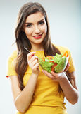 Woman diet concept portrait. Female model hold green salad. Stock Photography