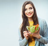 Woman diet concept portrait. Female model hold green salad. Royalty Free Stock Photo