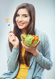 Woman diet concept portrait. Female model hold green salad. Royalty Free Stock Photography