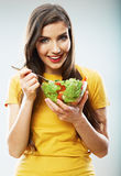 Woman diet concept portrait. Female model hold gre Stock Images