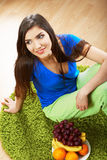 Woman diet food. Model seat on a floor. Stock Photography