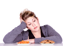 Woman on diet making eating choices Stock Photography