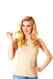 Woman on diet with measure-tape on fork Royalty Free Stock Photos