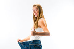 Woman on diet with oversized pants Stock Images