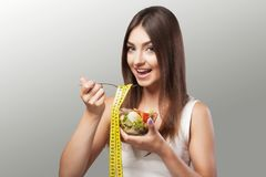 Woman. Diet. Portrait. Womens model with green salad. Adherence Stock Image