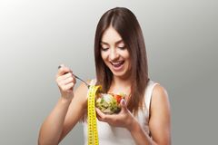 Woman. Diet. Portrait. Womens model with green salad. Adherence Royalty Free Stock Photo