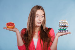 Woman with diet weight loss pills and grapefruit. Stock Photography