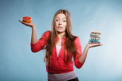Woman with diet weight loss pills and grapefruit. Royalty Free Stock Photos