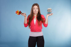Woman with diet weight loss pills and vegetables. Royalty Free Stock Photos