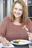 Woman On Diet Writing Details In Food Journal Stock Photo