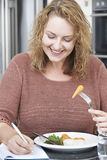 Woman On Diet Writing Details In Food Journal Royalty Free Stock Photo