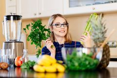 Woman dietetic in kitchen. Female preparing fruit and vegetable smoothie. Fresh organic food stock images