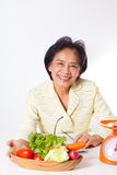 Woman dietician. With a bowl of vegetable Stock Photos