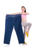 Woman in dieting concept. With big jeans Royalty Free Stock Images