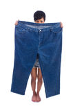 Woman in dieting concept. With big jeans Stock Photography