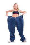 Woman in dieting concept. With big jeans Royalty Free Stock Photos