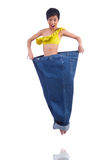 Woman in dieting concept. With big jeans Stock Photo