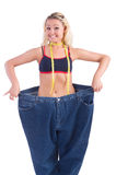 Woman in dieting concept. With big jeans Royalty Free Stock Photography