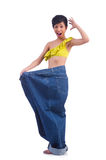 Woman in dieting concept. With big jeans Stock Images