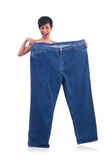 Woman in dieting concept. With big jeans Royalty Free Stock Photo