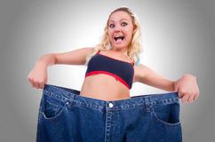 Woman in dieting concept. With big jeans Stock Image