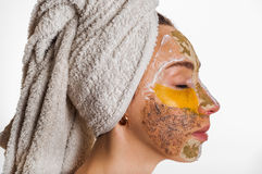 Woman with different masks on her face Stock Images