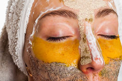 Woman with different masks on her face Stock Image