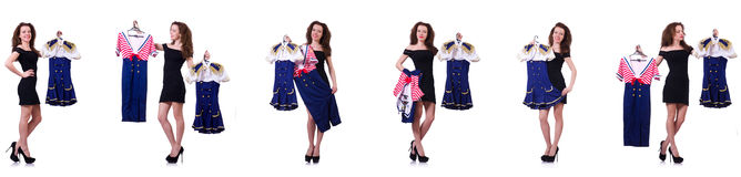 The woman with difficult choice of choosing clothing. Woman with difficult choice of choosing clothing Royalty Free Stock Image