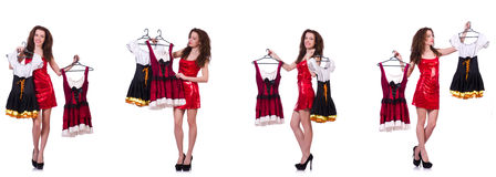 The woman with difficult choice of choosing clothing Royalty Free Stock Photo