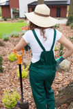 Woman after digging flowerbeds Royalty Free Stock Photos
