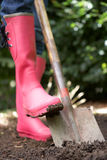Woman digging in garden Royalty Free Stock Photo
