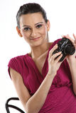 Woman with digital camera Stock Images
