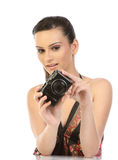 Woman with digital camera. On the white background Stock Images