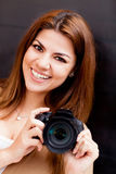 Woman with a digital camera Royalty Free Stock Images