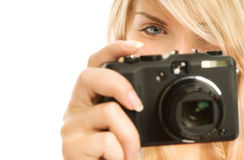 Woman with digital camera. Beautiful smiling woman with digital camera. Isolated on white background Stock Photo