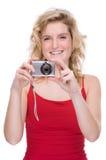Woman with digital camera Stock Photos