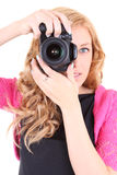 Woman with digital camera in hands Royalty Free Stock Images