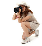 Woman with digital camera in hat Stock Image