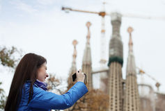 Woman with digital camera photographing  Sagrada Familia Royalty Free Stock Image