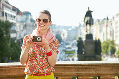 Woman with digital camera standing near National Museum, Prague Stock Photography
