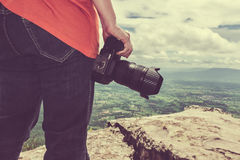 Woman with digital camera at view point on mountain. Travel life Royalty Free Stock Photos
