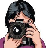 Woman and digital photo camera Stock Photos
