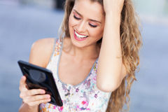 Woman with digital tablet. Attractive woman with digital tablet Stock Photography